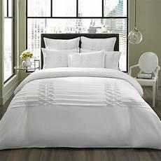 beautiful luxurious white textured comforter set