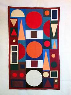 tableau contemporain graphique en patchwork textiles et