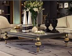 luxury coffee table with a grey graphite finish and gold