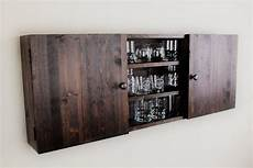 large wall mounted rustic wooden liquor cabinet home
