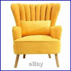 upholstered oyster shell scalloped wing back chair