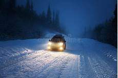 Snow Lights Car Car Lights In Winter Forest Stock Photo Image Of Snow