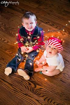 Baby Wrapped In Christmas Lights Photo 6 Month Old Session Older Brother Wrapped In Lights