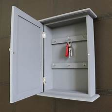 grey wall mounted wooden key cabinet browne