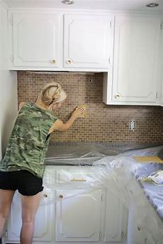 How To Backsplash How To Paint A Tile Backsplash A Beautiful Mess