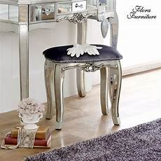 this stunning stool is ornate and mirrored a stool as