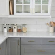 installing a subway tile backsplash in our kitchen the
