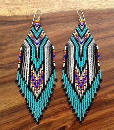 turquoise feather earrings by wildmintjewelry on etsy 82