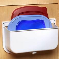 mounted lid caddy or plastic bag recycler in cabinet door