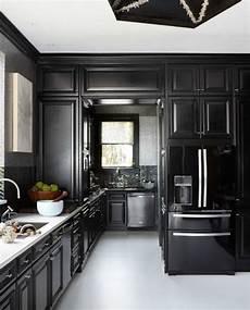 black kitchen design ideas 11 black kitchens black cabinet and backsplash ideas