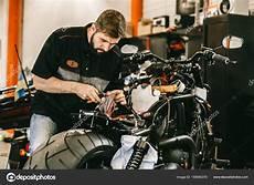 Motorcycle Mechanics Professional Motorcycle Mechanic Works With Electronics