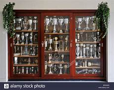 cabinet filled with football trophies in home of german