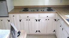 white cabinets with cabinet hardware and cabinet