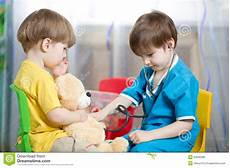 Children Play Doctor Kids Play Doctor With Plush Toy Stock Image Image Of