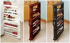 slim organizer rolling spice can holder between cabinet