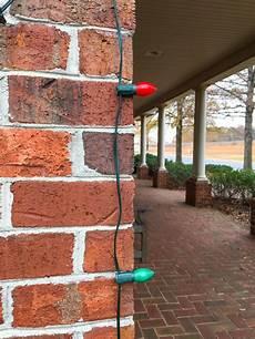 Fixing Christmas Lights To Brick How To Hang Christmas Lights On Brick Homes With A Glue Gun