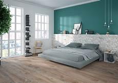 da letto con parete in pietra da letto dallo stile nordico e minimale gres