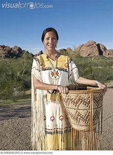 native american woman in traditional clothing with hand