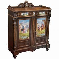 antique jelly cabinet with painted pastoral medallion