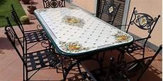 tavoli da giardino in pietra lavica basi e sedie in ferro battuto proposte da artesole