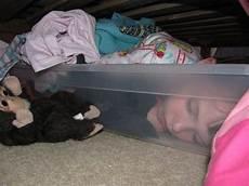sleeping in bed storage bin