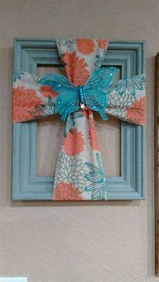 cross made from a picture frame and burlap burlap
