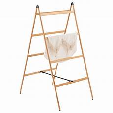 bamboo clothes rack bamboo ladder clothes drying rack the container store