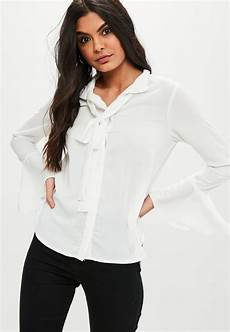flair sleeve blouse missguided white bow flare sleeve blouse in white lyst