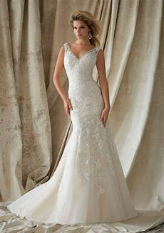beaded embroidery with lace on net bridal gown