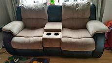2 seater recliner sofa with cup holders and storage for