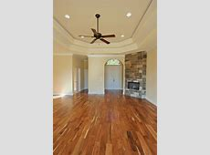 "This home features a wood burning fire place and gorgeous ""Tobacco Road"" acacia wood floors"