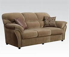 light brown velvet sofa with pillows