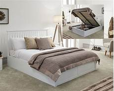 connect white wooden ottoman bed frame