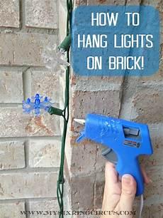Fixing Christmas Lights To Brick 10 Tricks To Make Hanging Christmas Decorations Way Easier