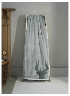 luxury soft sherpa throw in silver grey with stag
