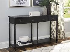 signature design by eirdale black console sofa