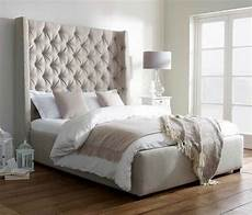 king size bold headboard upholstered bed in