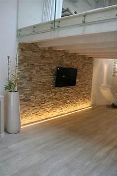 parete rivestita in legno parete rivestita in spaccatello di quarzite beige