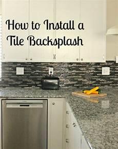 installing backsplash tile in kitchen how to install a glass tile backsplash she buys he builds