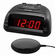 global 360 black vibrating alarm clock ttc 360bk bed