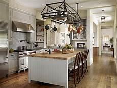 kitchen island with pot rack above the island pot rack cottage kitchen tim barber