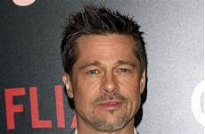 brad pitt makes rare appearance at art auction and is