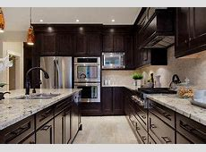 I think this is the colours I'm going to go with for my kitchen! Dark cabinets, light granite