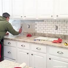 installing kitchen tile backsplash how to install a kitchen backsplash how to nest for less