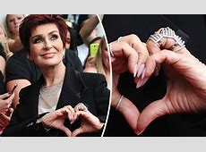 Sharon Osbourne covers wedding finger with HUGE ring at X