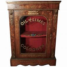 superb figured walnut perfume cabinet from barkers of