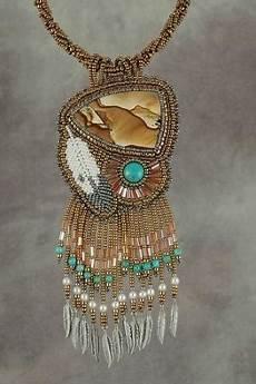 beaded feather earrings beadwork via etsy beadwork