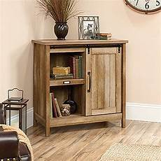 sauder adept craftsman oak accent storage cabinet with
