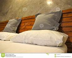 throw pillows and pillow on white bed stock photo image