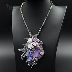 beadwork necklace with purple swarovski crystals
